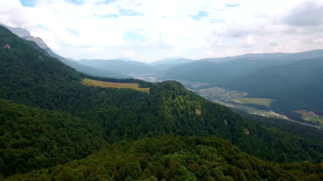 Aerial view of mountains landscape town valley scenery video