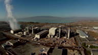 Aerial view of natural gas power plant fly in video