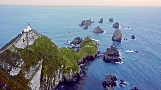 Aerial view of Nugget Point Lighthouse, Otago, New Zealand video