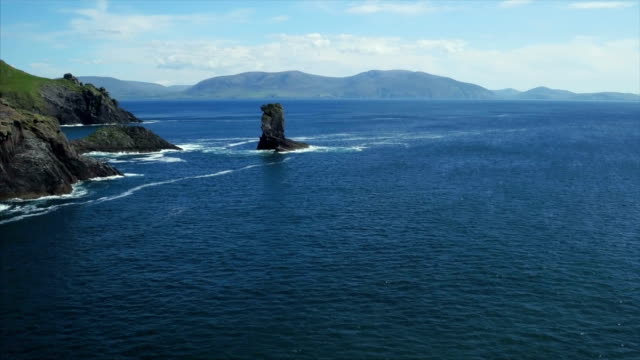Aerial view of ocean and sea stack on coastline video