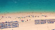 Aerial view of people enjoying on the Greek Lefkada sandy beach video