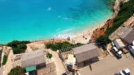 Aerial view of people enjoying on the Greek Lefkada sandy beach video