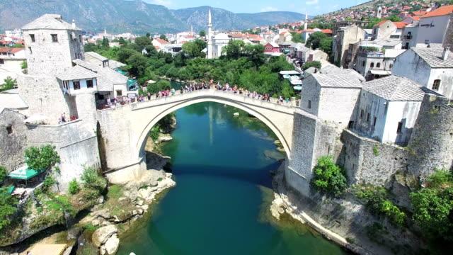 Aerial view of people walking over bridge in Mostar, Bosnia. video