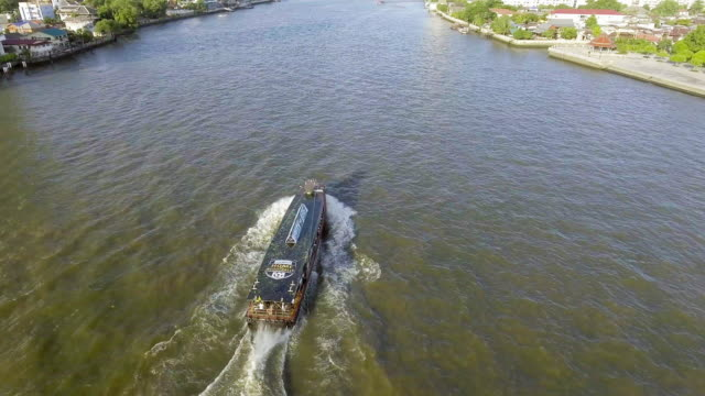 Aerial view of public transportation boat in the Chaopaya river, Bangkok video