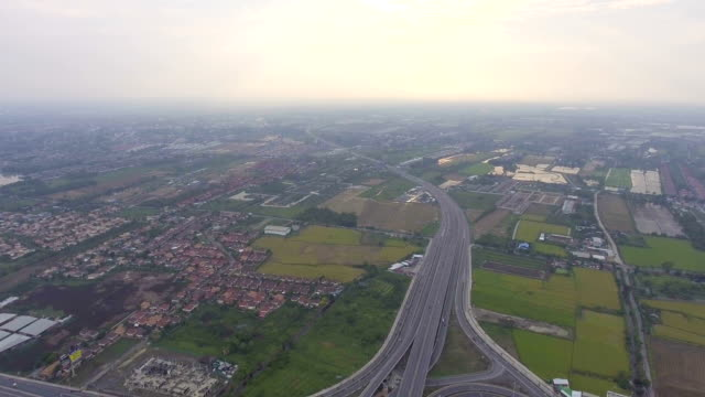 Aerial view of residential area and highway in Bangkok at dusk, Thailand video