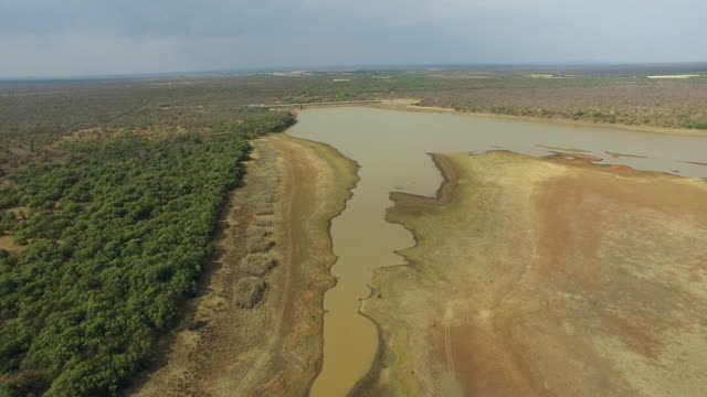 Aerial view of retreating water for agriculture and drinking in storage dams due to a drought video