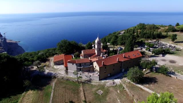 Aerial view of Rezevici Monastery a Serbian Orthodox monastery located in Katun Rezevici village between Budva and Petrovac video