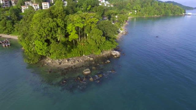 Aerial view of rock on coastline of Phuket Island near Patong Beach, Thailand video