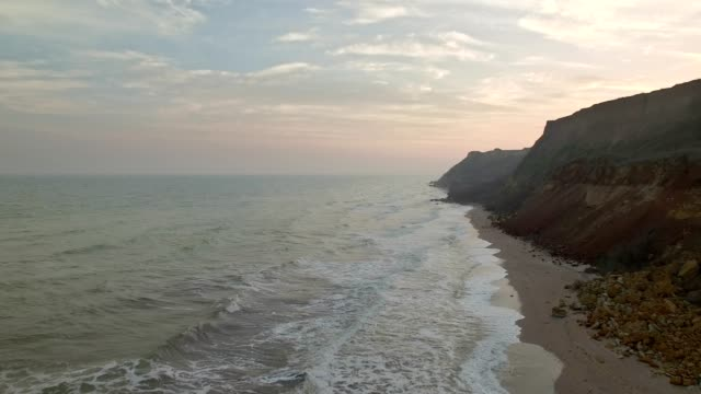 Aerial view of rocky mountains and sea waves video