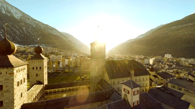 aerial view of romantic church building sunset village town video