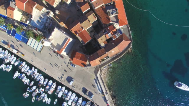 Aerial view of rooftops and harbour in Komiza, Croatia video
