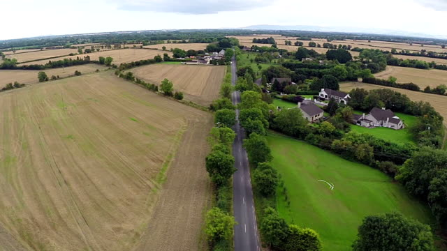 Aerial view of rural houses and roads in Ireland video