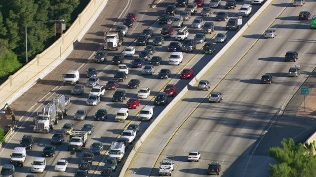 Aerial view of rush hour traffic on busy freeway video