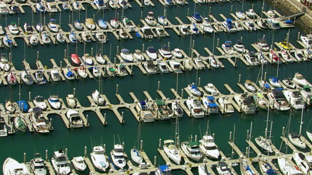 Aerial view of sail boats docked in harbor video