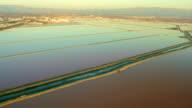 Aerial view of salt water ponds in natural wetlands video