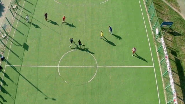 Aerial view of school college team playing football, active rest video