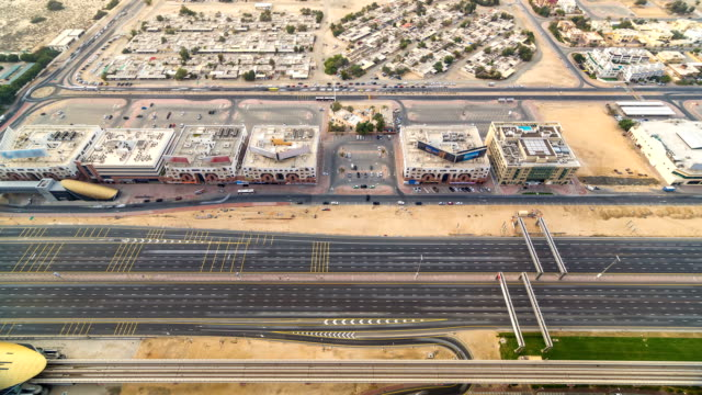 Aerial view of Sheikh Zayed highway road timelapse in Dubai with traffic and a metro station video