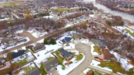 Aerial view of small town USA, middle-class neighborhoods, some snow video