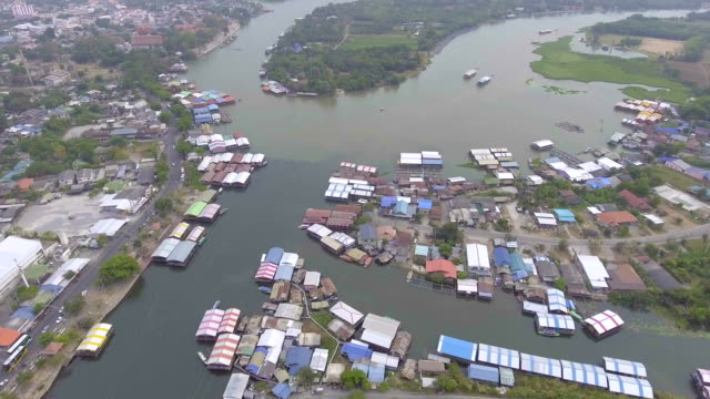 Aerial view of small village and mount of river video