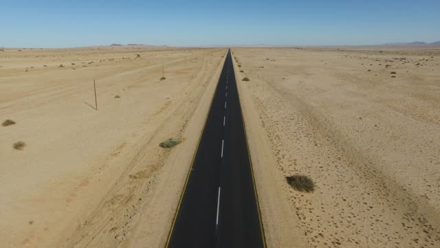 4K Aerial view of straight tar road through the Namib desert video