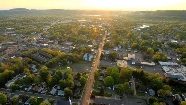 Aerial view of sunrise over suburban landscape video