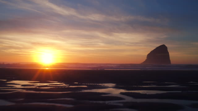 Aerial View of Sunset Reflecting on Amazing Tide Pool Water Pattern on Beach in Pacific Northwest video