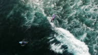 Aerial view of surfers at the water's edge. Indian ocean. Bali. Big waves in the sea video