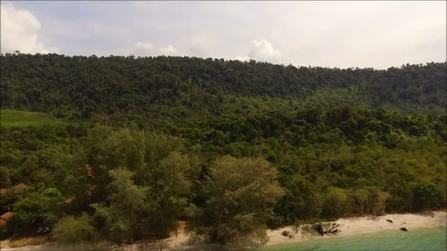 Aerial view of Thailand's east coast and the tropical forest in Trat Province by drone video