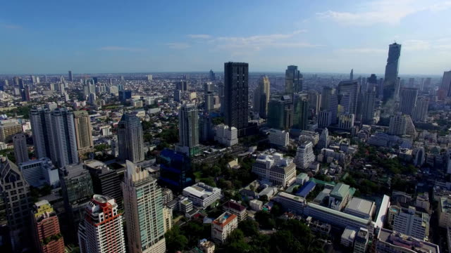 Aerial: View of the center of Bangkok, traffic and business buildings. video