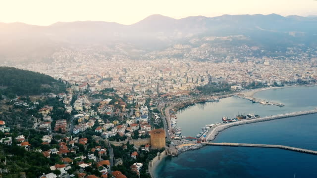 Aerial view of the hill castle and the coast city with marina video