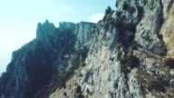 Aerial view of the movement of the funicular in the fog, mountain in Crimea, Ay Petri. Funicular railway, cable-railway, cableway. video