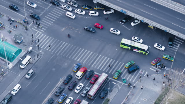 T/L MS HA PAN Aerial View of the Zebra and Pedestrians Cross / Beijing, China video