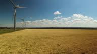 Aerial view of three wind turbines video