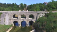 Aerial view of Tounj Bridge, double bridge over river Tounjcica, Croatia video