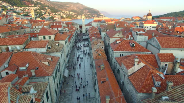 Aerial view of tourists walking on Stradun at sunset video