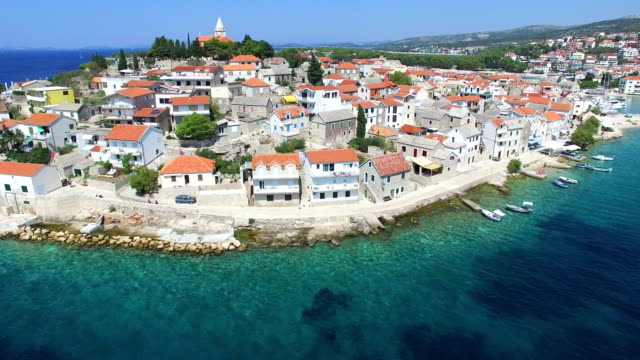 Aerial view of traditional dalmatian town with church in the middle, Croatia video