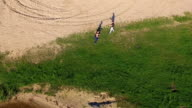Aerial view of training Wing Chun on a coast between trainer and boy video