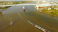 aerial view of tug boat or ship, container transportation ship on chao phraya river, transportation concept, tilt-up camera shot, HD video