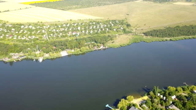 Aerial View Of Village Near River, Drone Shot Of Rural Summer Landscape video