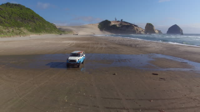 Aerial view of vintage vehicle on beach video