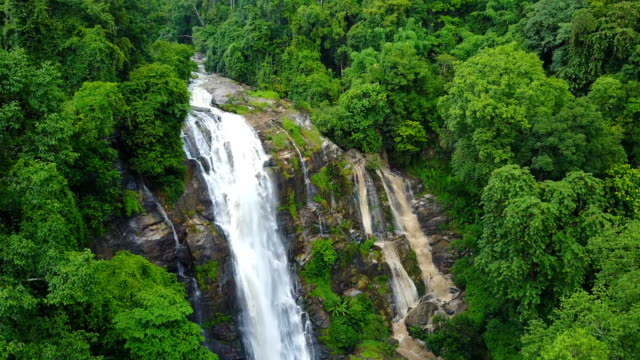 Aerial view of Wachirathan waterfall with spray of water Splashing one of the famous waterfall at Doi Inthanon National Park mountain. Located in Chiang Mai, Thailand. video