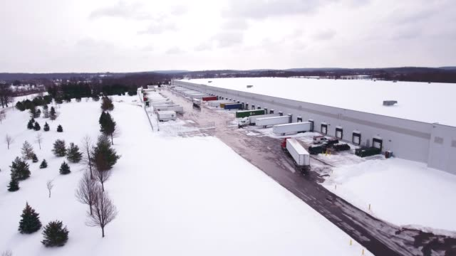 Aerial view of warehouse lot in winter video