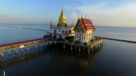 aerial view of wat hong thong once of temple church on sea coastal in thailand video