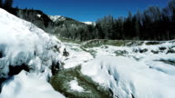 aerial view of waterfall. snowcapped winter landscape video