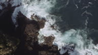 Aerial view of waves crashing on the shore video