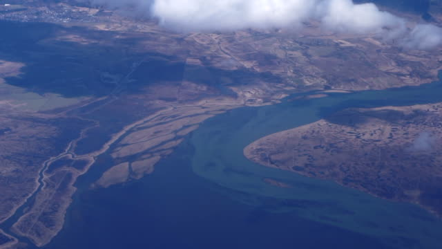 Aerial view of West Europe landscape. Melted snow river runs in to ocean video