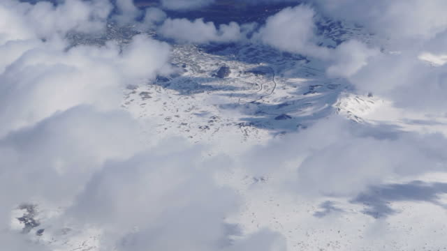 Aerial view of West Europe landscape. White snow wonderland all over mountain line video