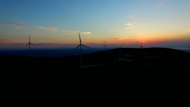 Aerial view of white elegant windmills at sunset video