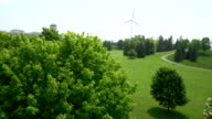 Aerial view of wind turbine and nuclear power plant video