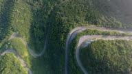 Aerial view of winding road in forest video